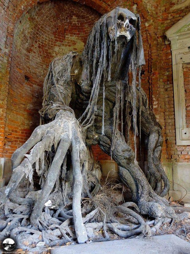 Demon Statue in old mausoleum